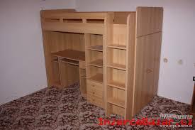 Dětská patrová postel se skříní a psacím